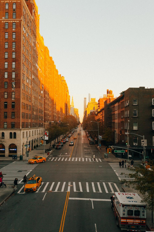 concrete road beside building during golden hour