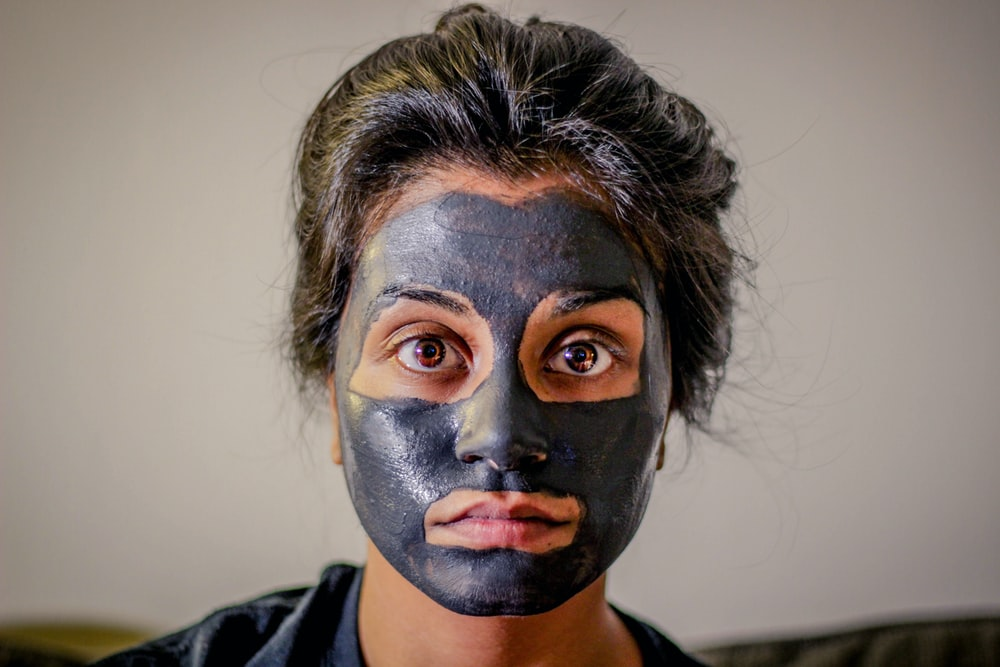 woman with gray facial mask