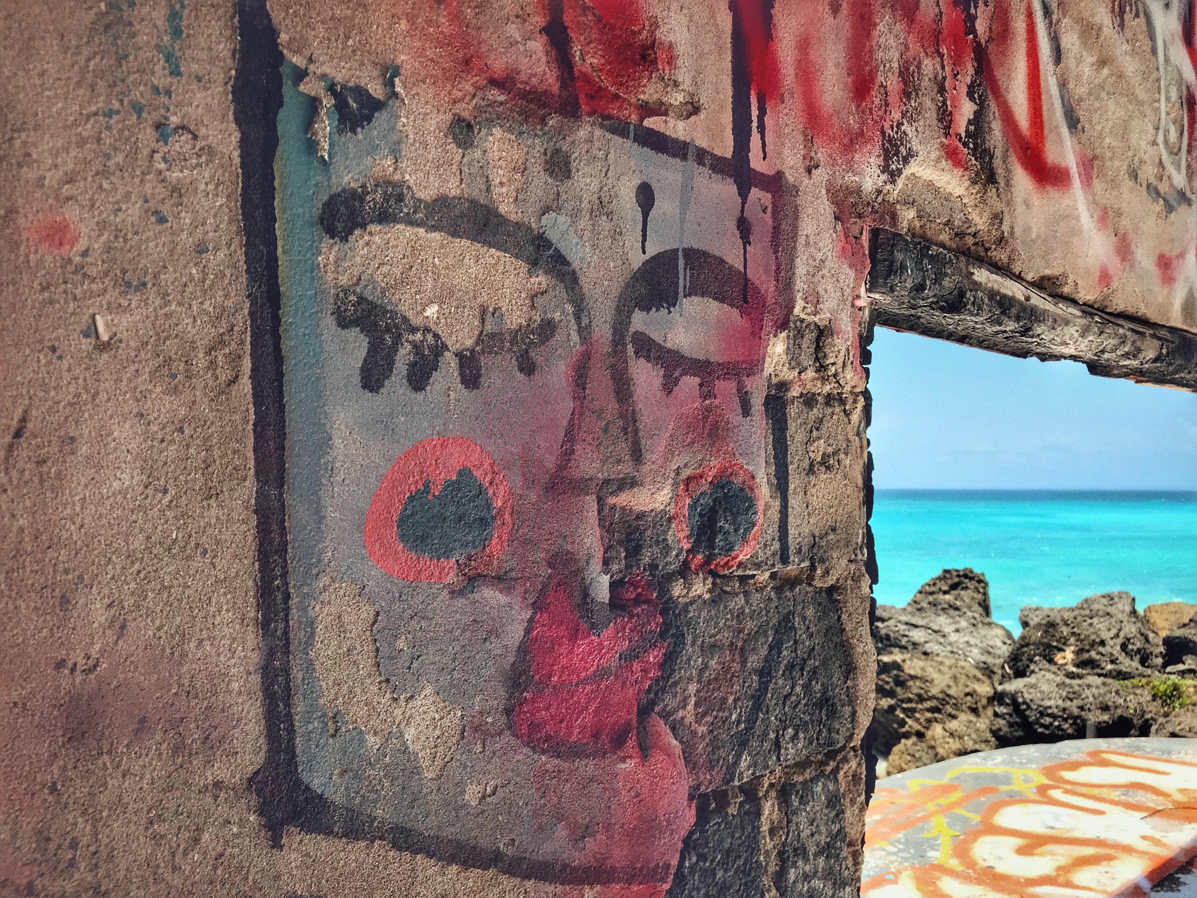 graffiti near body of water