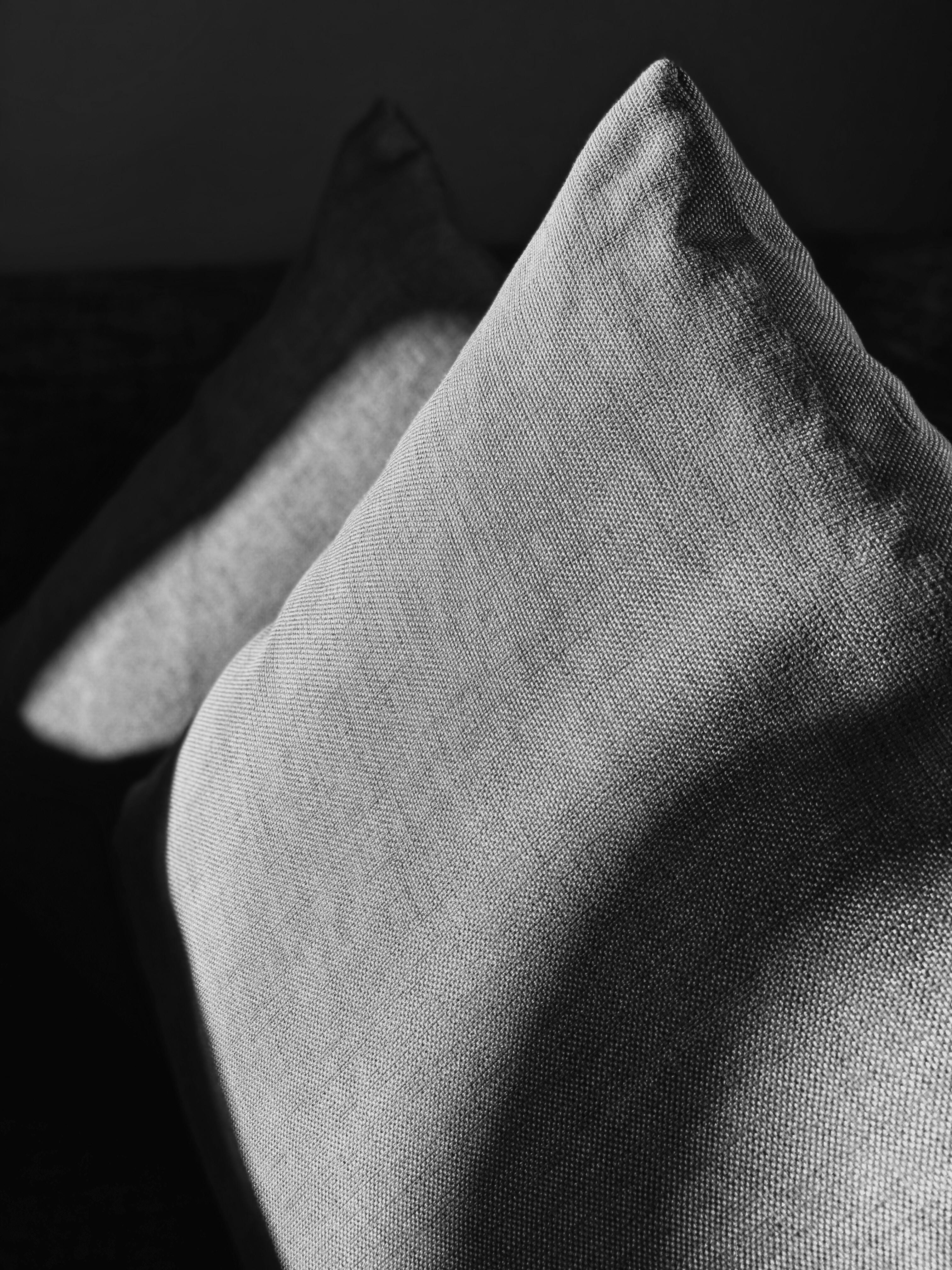 two grey throw pillows closeup photography