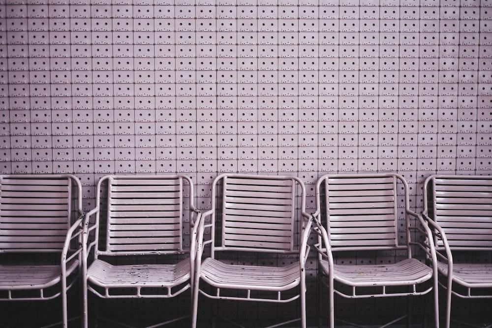 white metal armchair lot