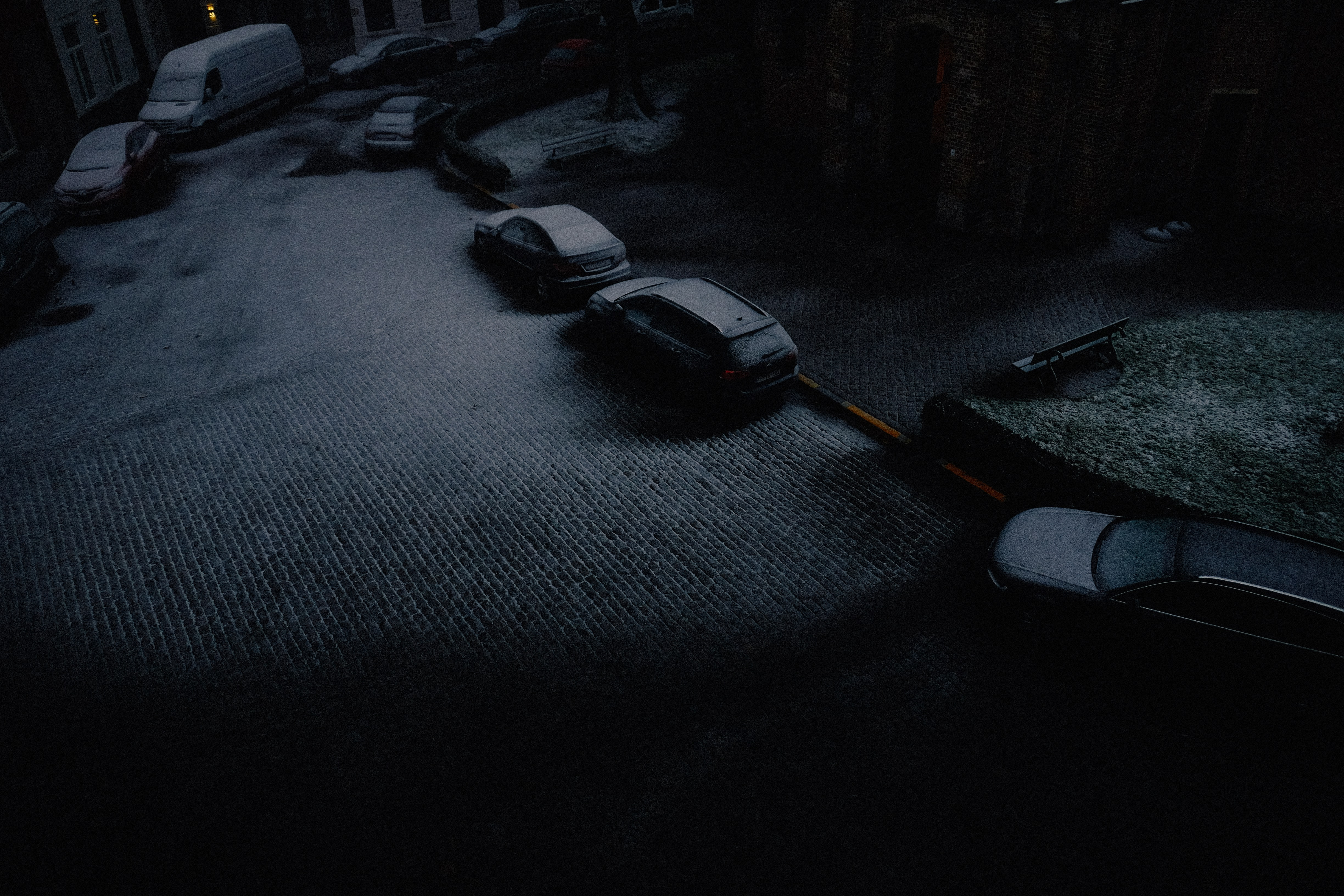 vehicles parked beside road covered with snow