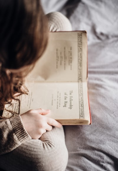 photography of person holding book