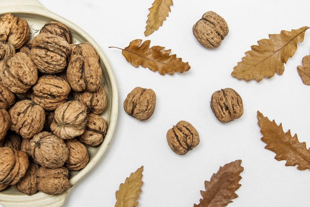 brown walnuts on beige ceramic bowl