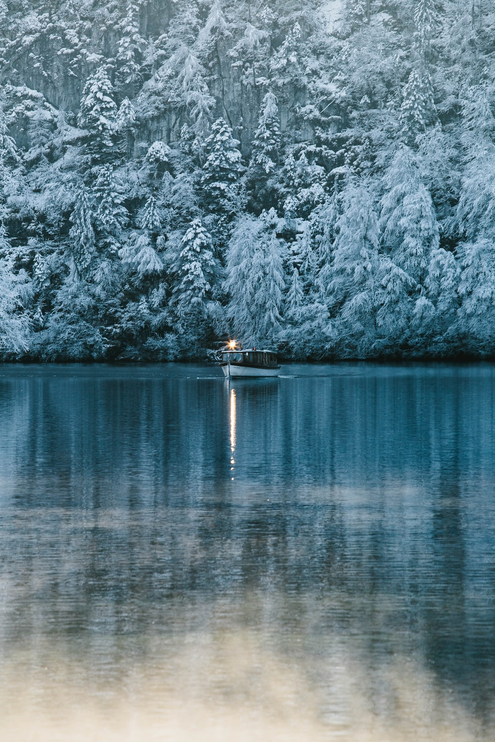 white sailing boat on river