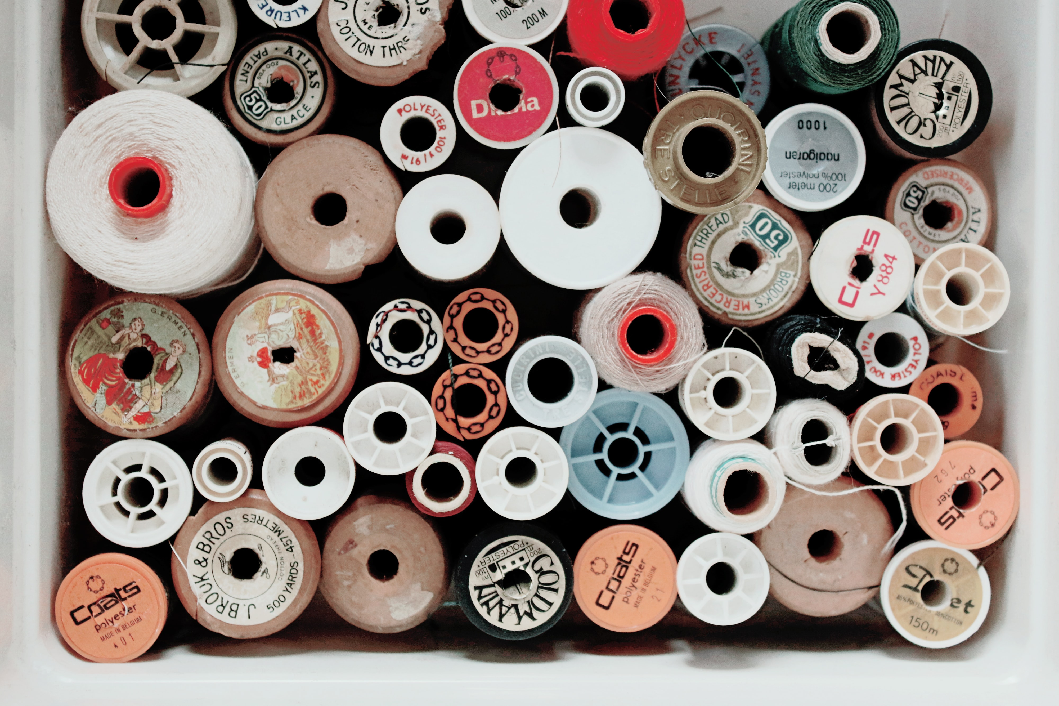 assorted-color threads in white box