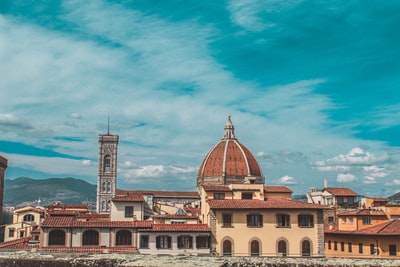 brown and beige concrete buildings florence teams background