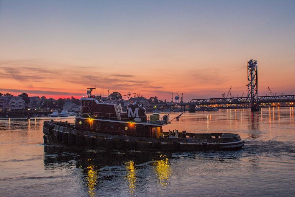 pontoon boat with bridge as background photo