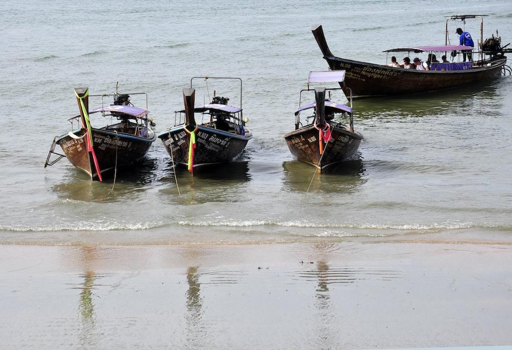 four canoes on beach