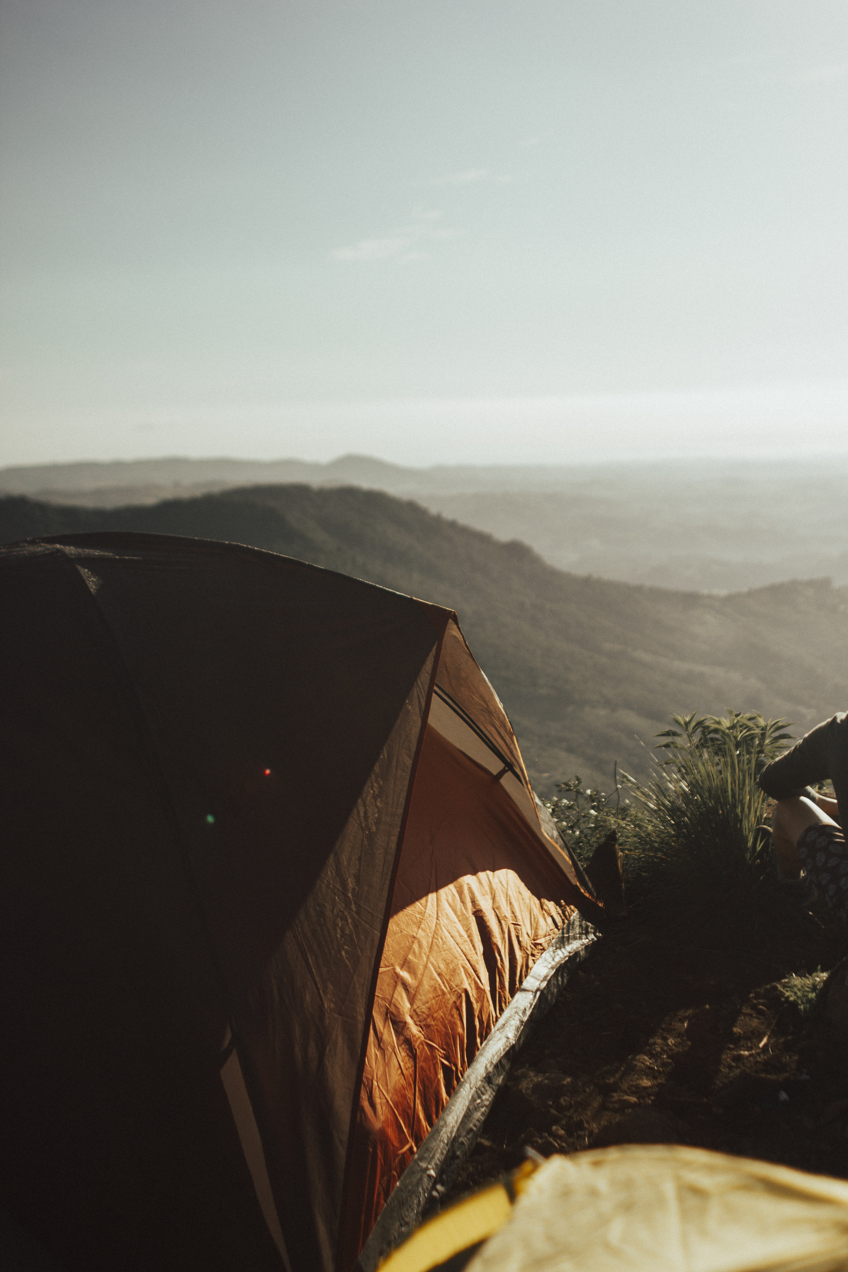 brown tent on moutains