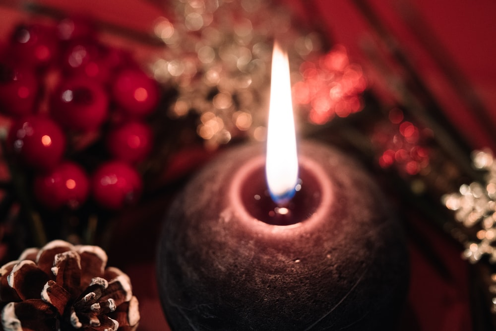 selective focus photography of flamed candle