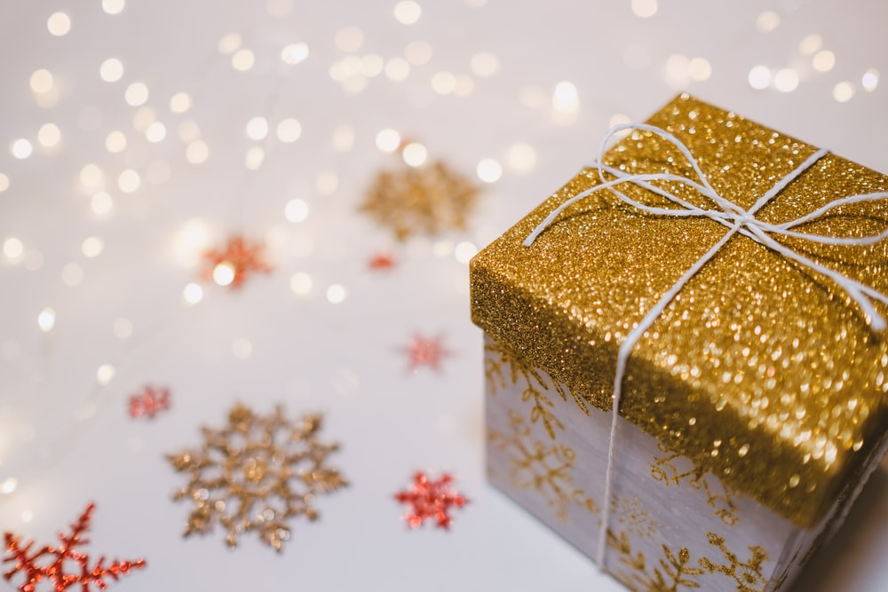 Christmas gift wrapped in gold for teachers