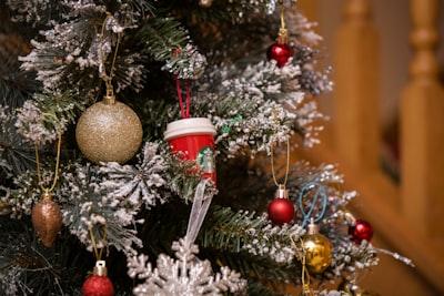 shallow focus of christmas tree santa's elves teams background
