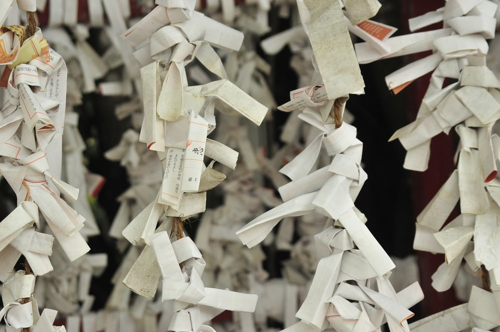 white printer papers arranged into buntings hanging decorations