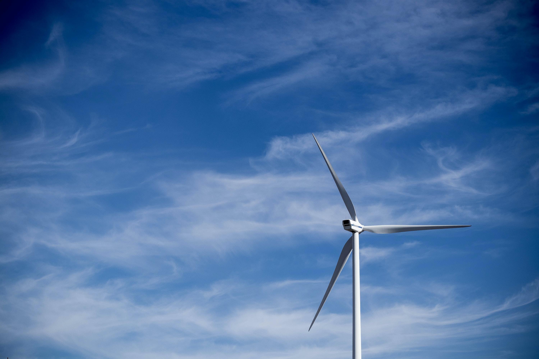 tilt-shift photography of white windmill during daytime