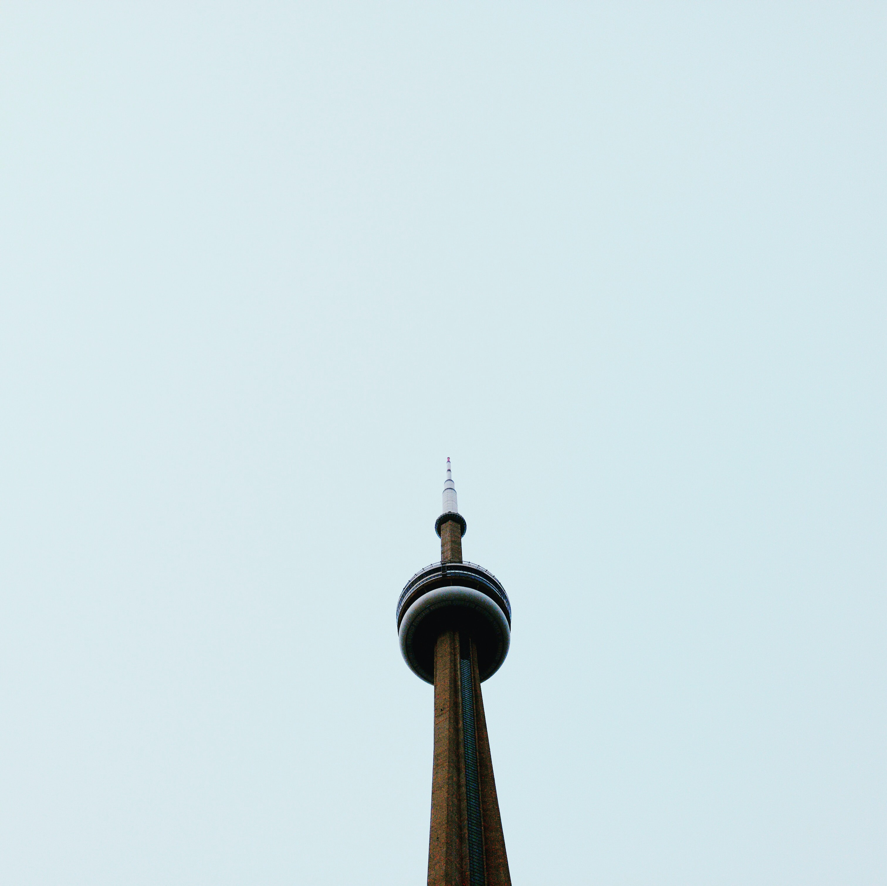 low angle photography of CN tower under blue sky during daytime