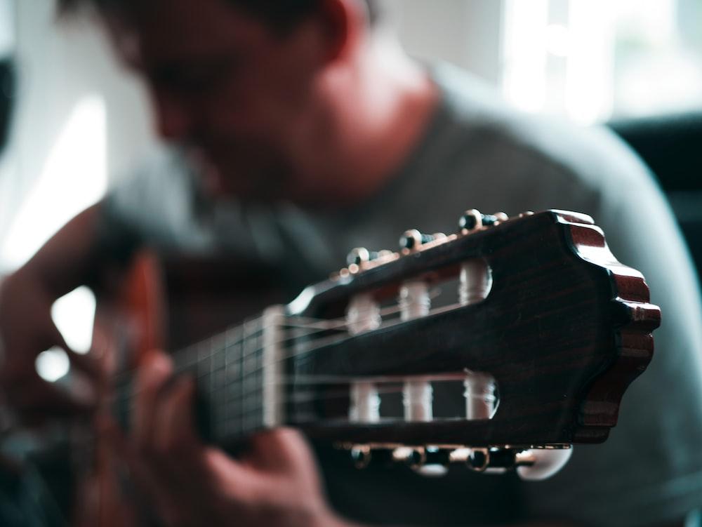 tilt-shift lens photography of headtock - 5 practice habits for musicians