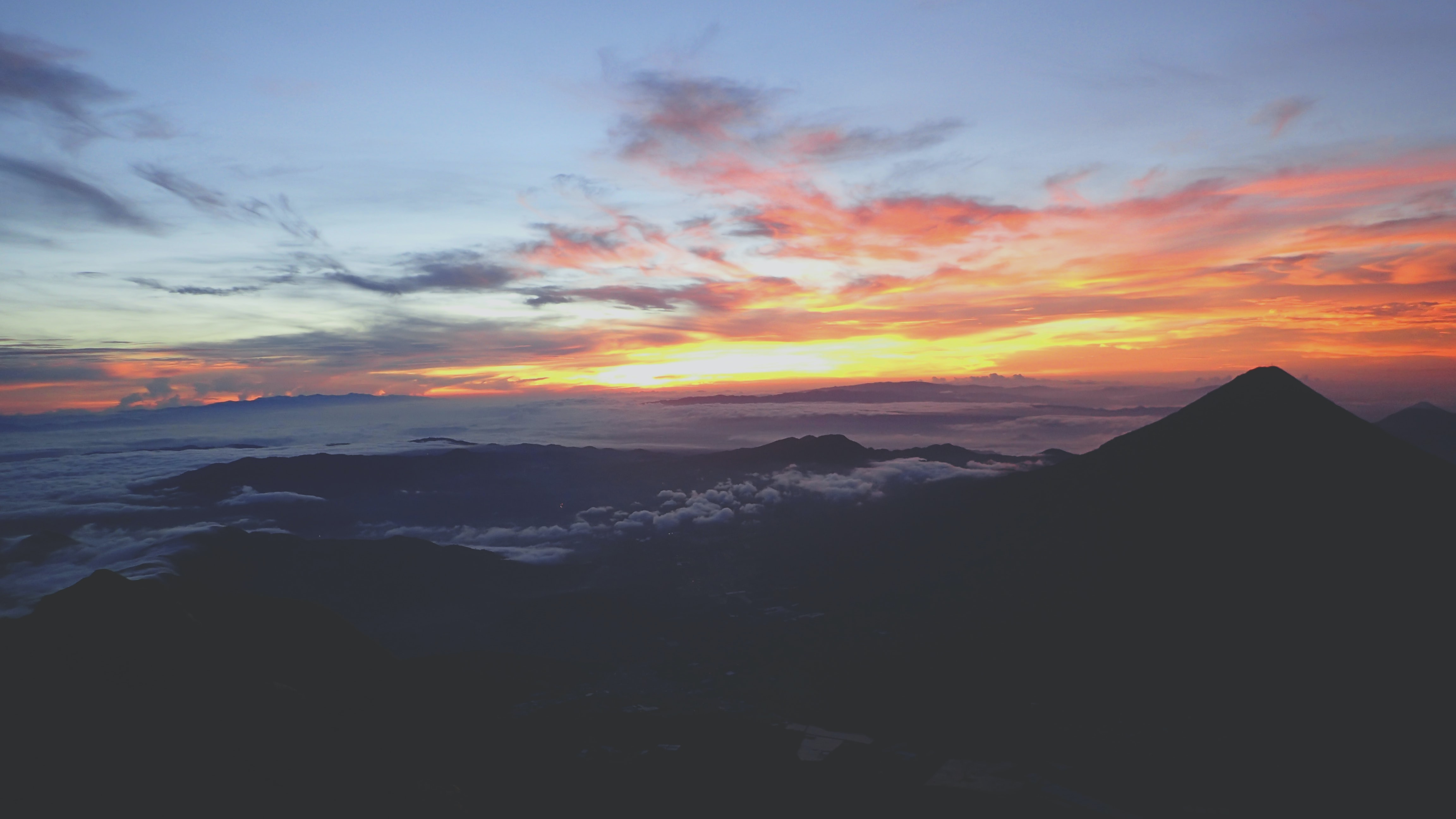 mountain range covered with clouds during sunset landscape photography