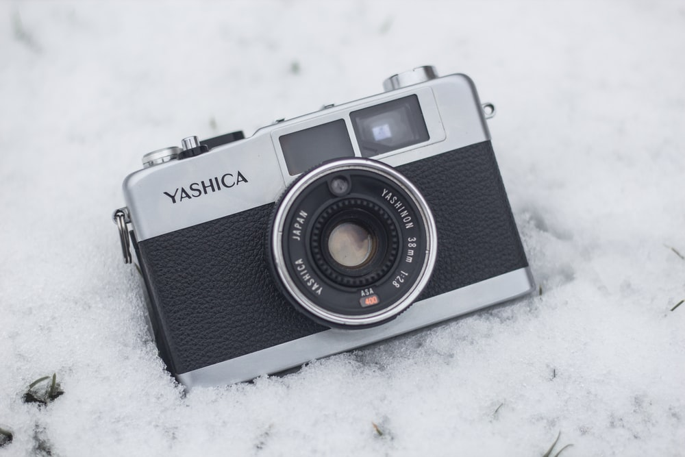 gray and black Yashica camera on snow