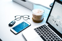 clear eyeglasses near laptop
