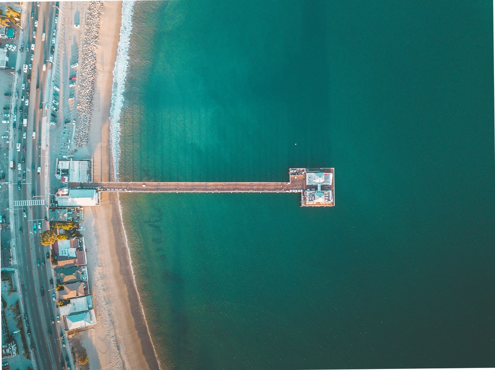 aerial view photography of green sea near dock at daytime