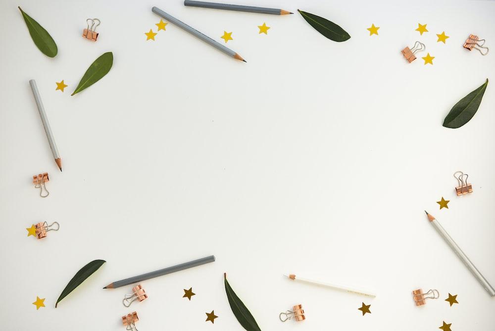 pencils on white panel