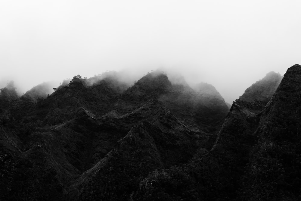 mountains surrounded by low clouds
