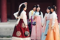 group of woman wearing traditional dresses