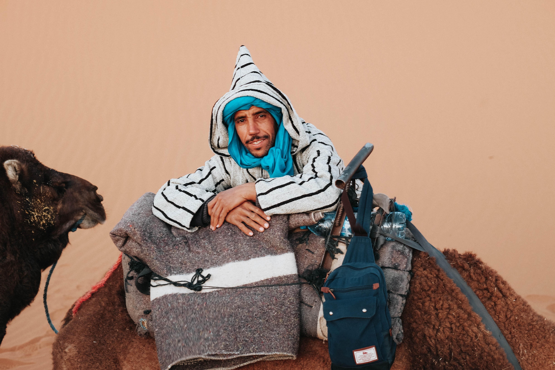 man ride on camel