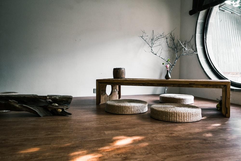 brown wooden bench near window