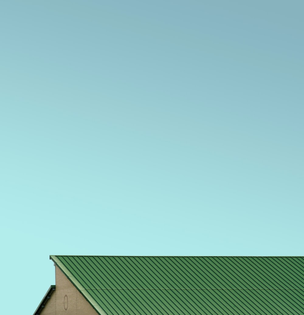 green house roof under blue sky