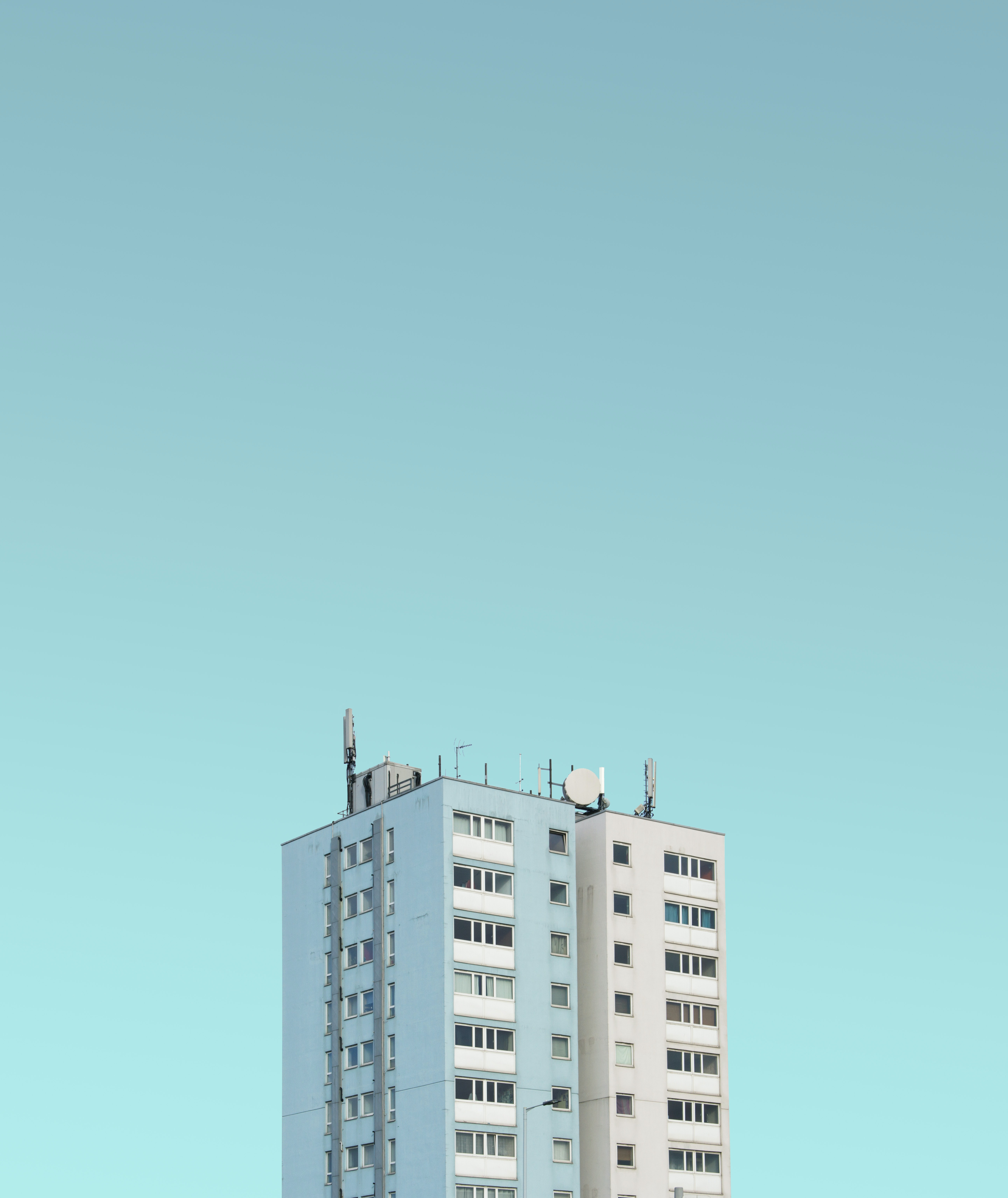 white painted high-rise building under clear sky