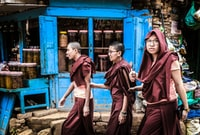 """It's usually a common sight to see nuns walking along the streets of Kathmandu.  However, this was a perfect capture as """"the smiles"""" on their face and the contrast of the background colors makes the storytelling much easier."""