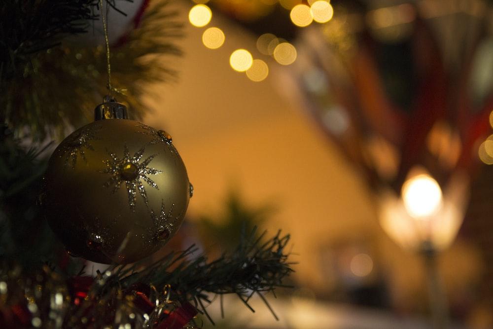 tilt-shift lens photo of gold Christmas bauble