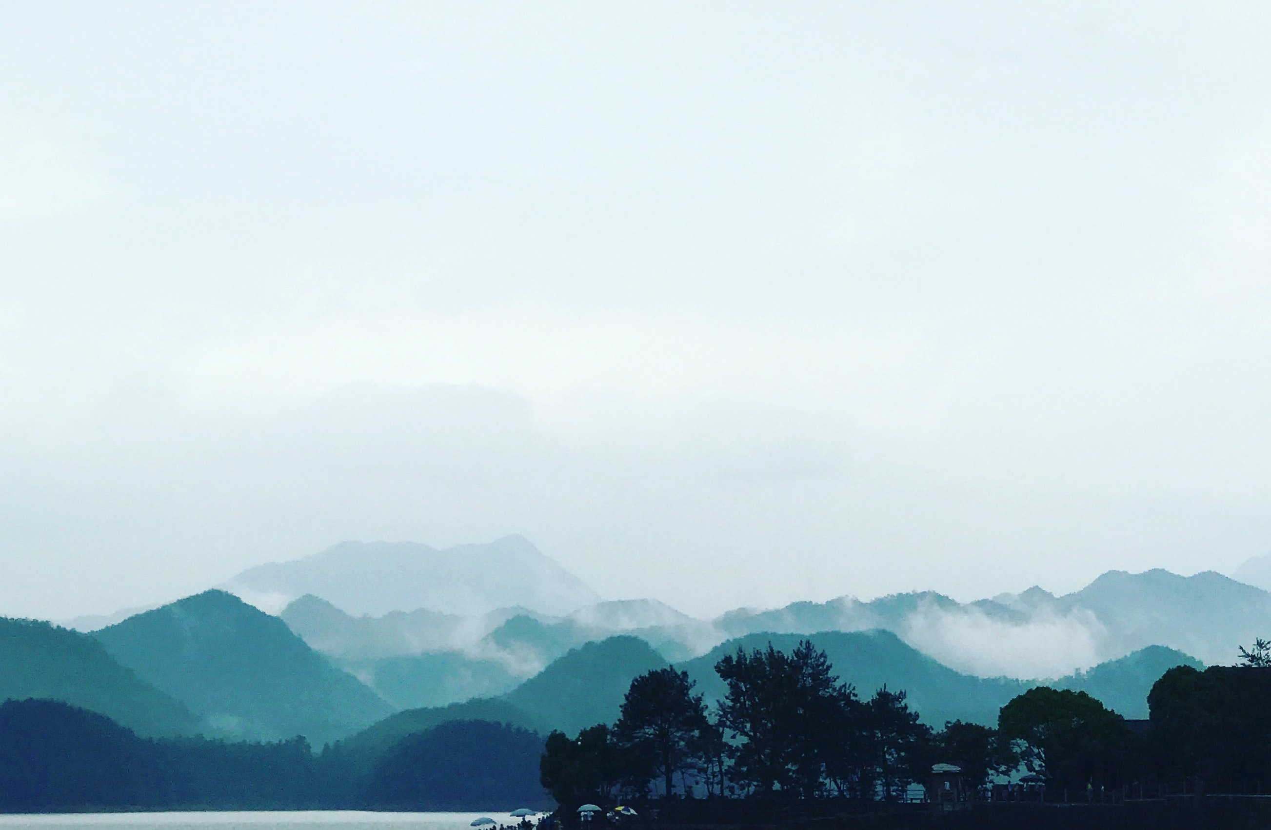 landscape photography of mountains nearby sea