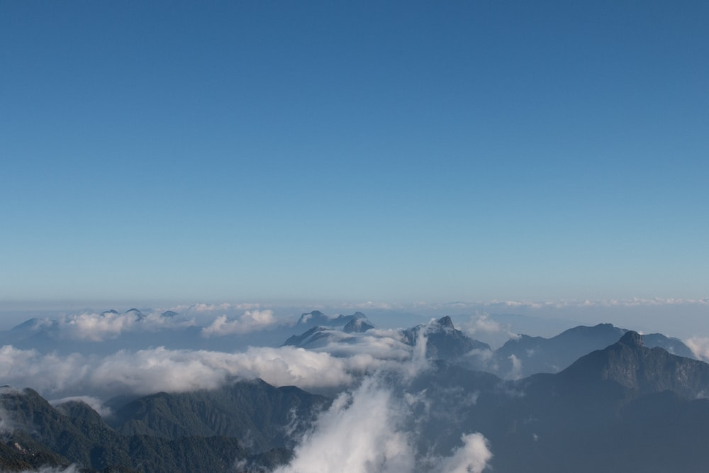 aerial photo of mountain with sea of clouds