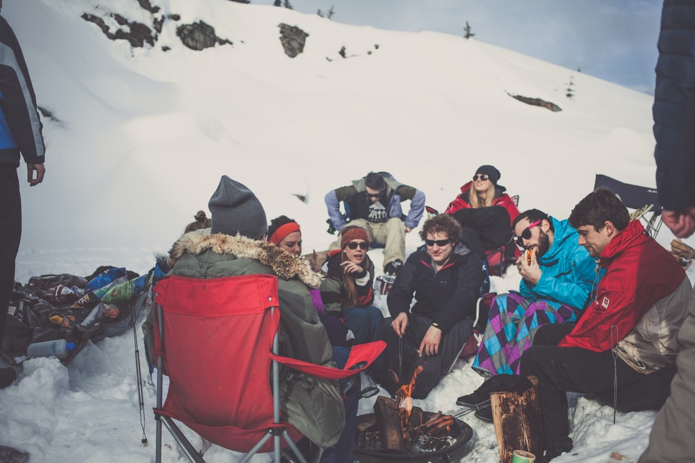 people on snowfield during daytime