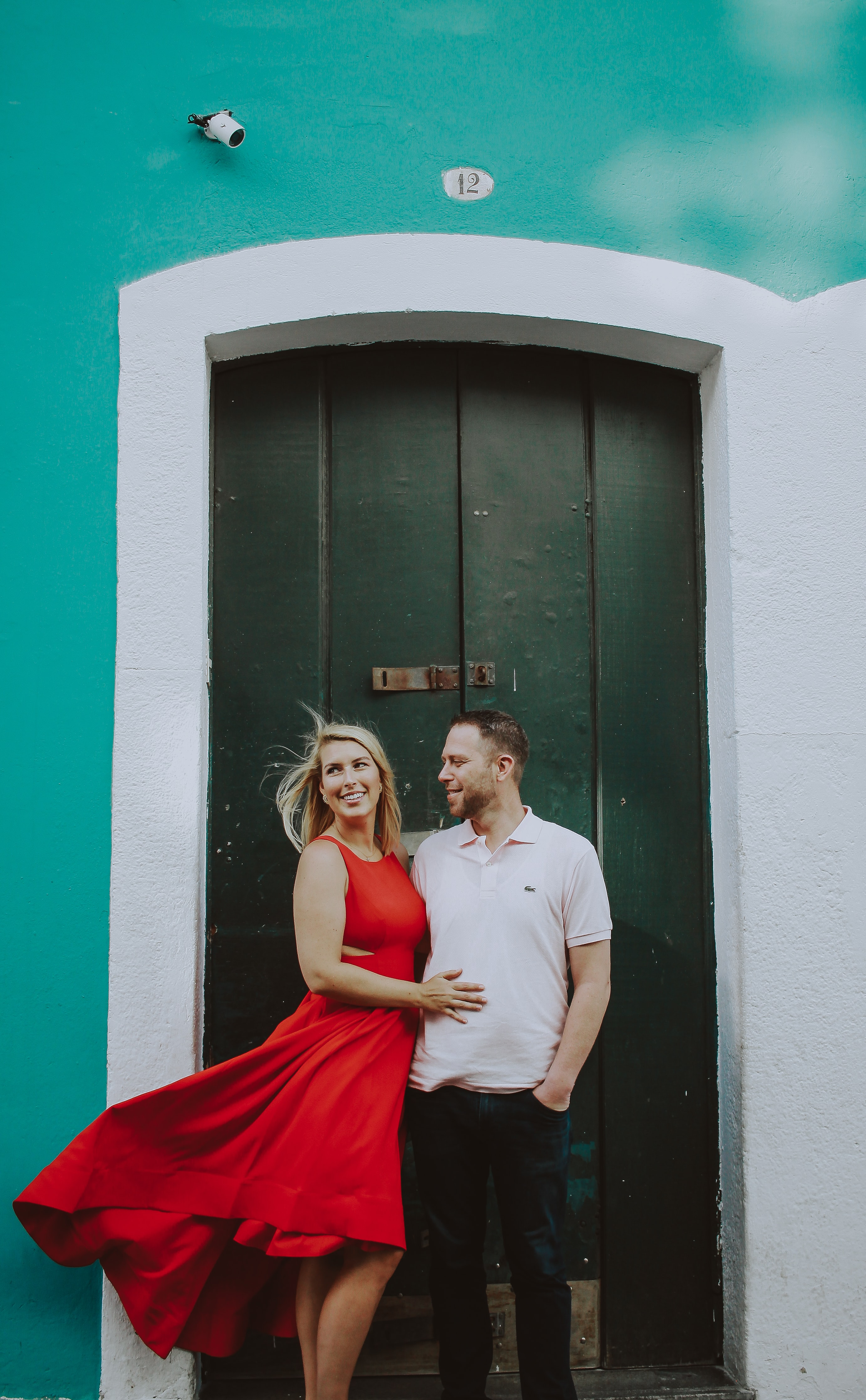 man and woman standing near door during daytime