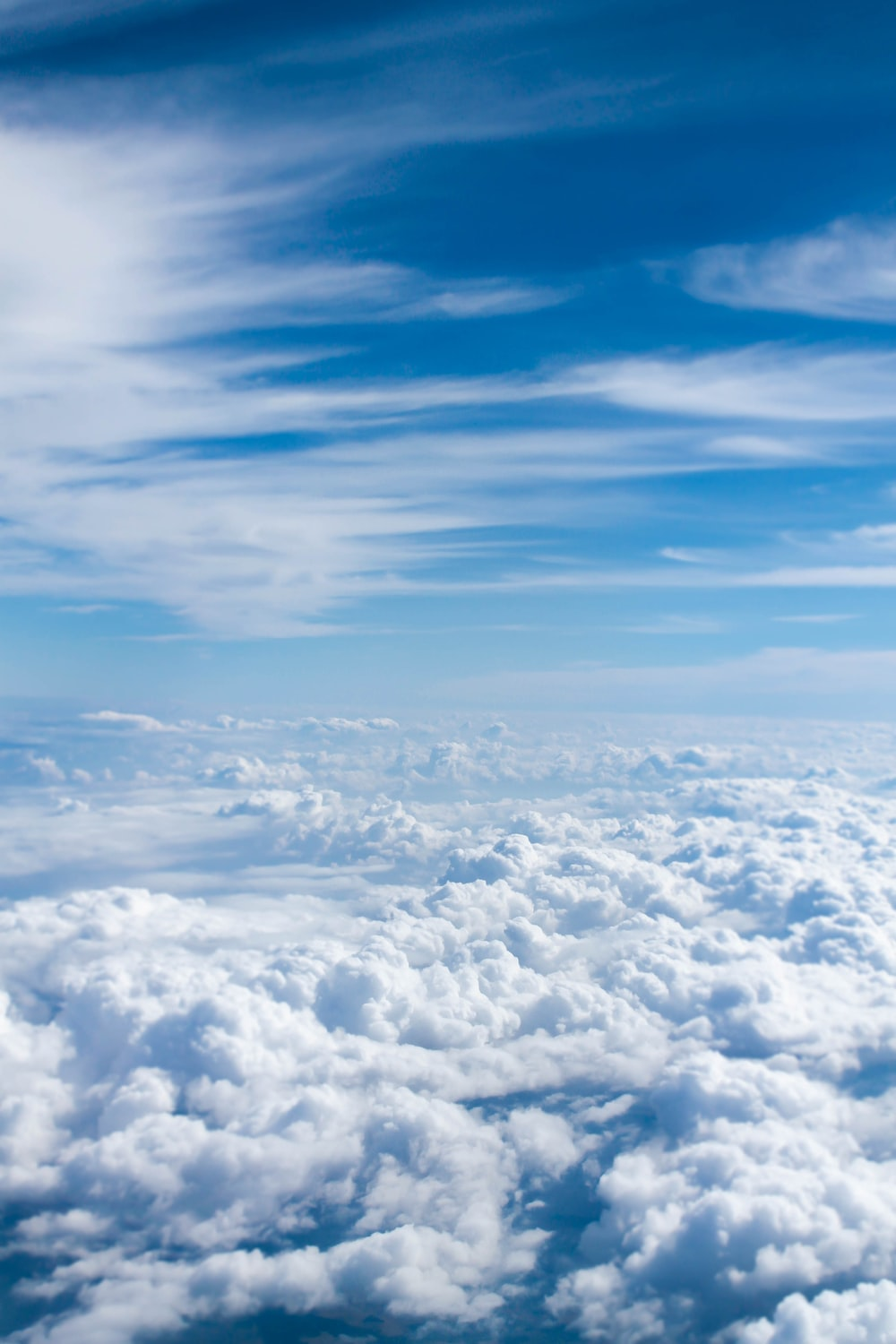 above-cloud photo of blue skies
