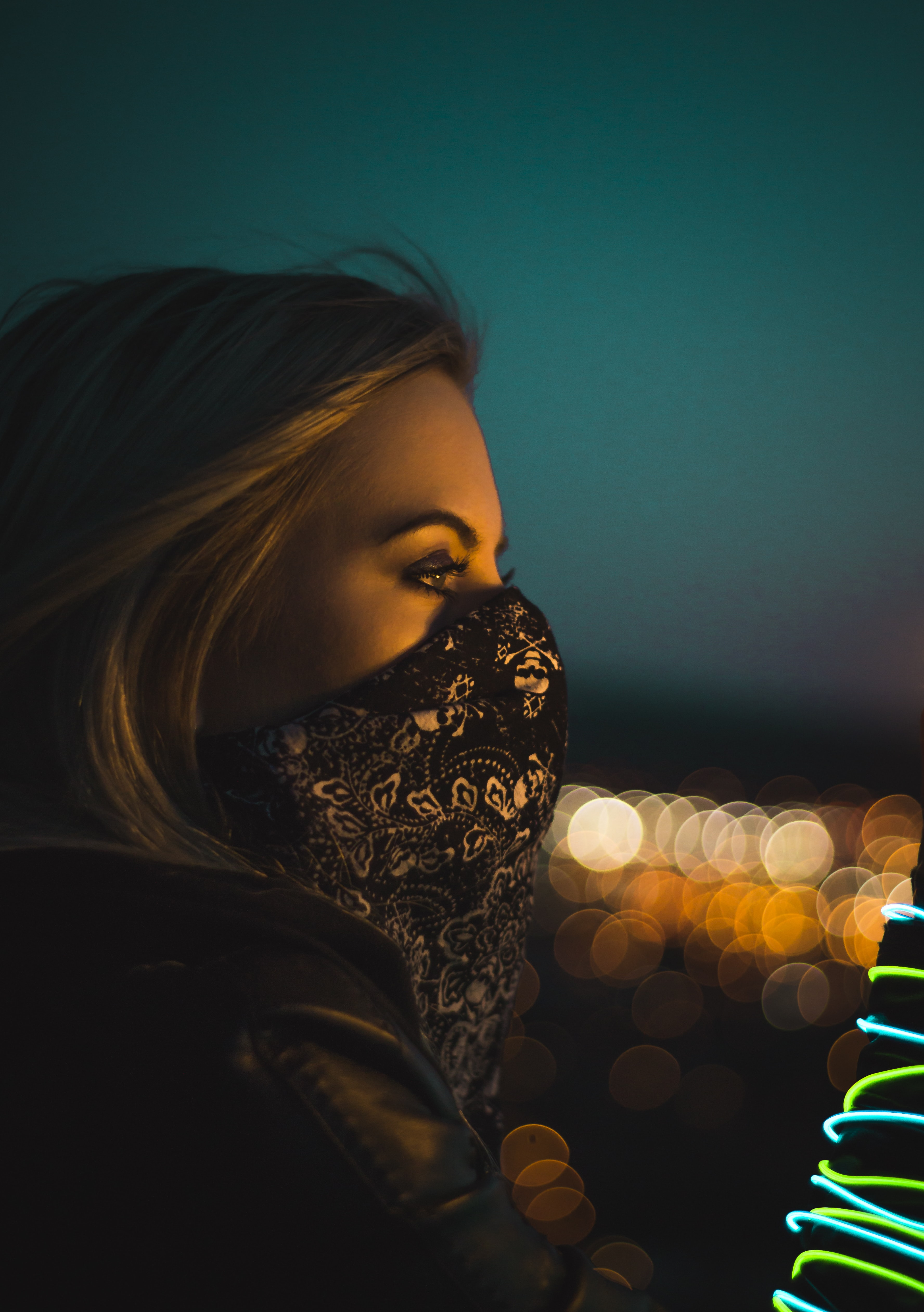 woman wearing black and white floral face mask during nighttime