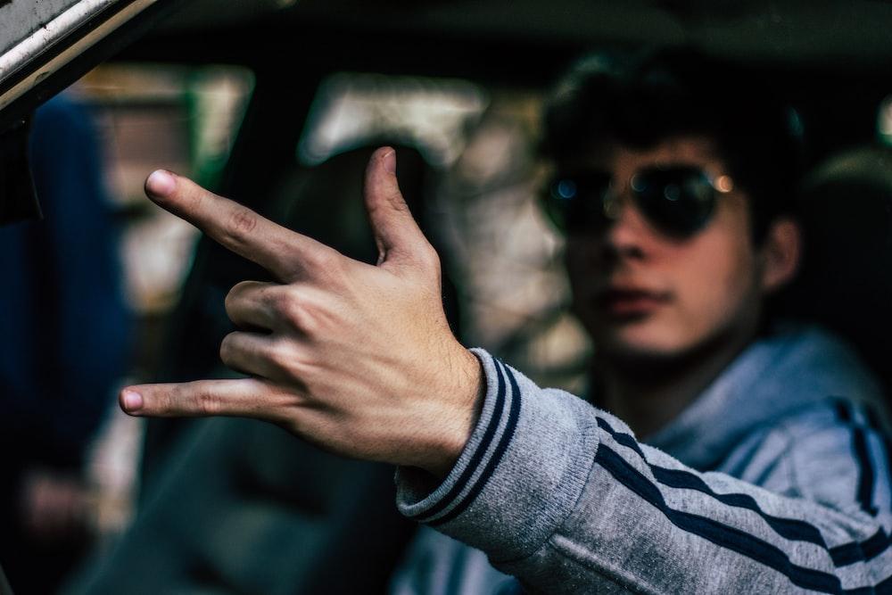man inside car during daytime