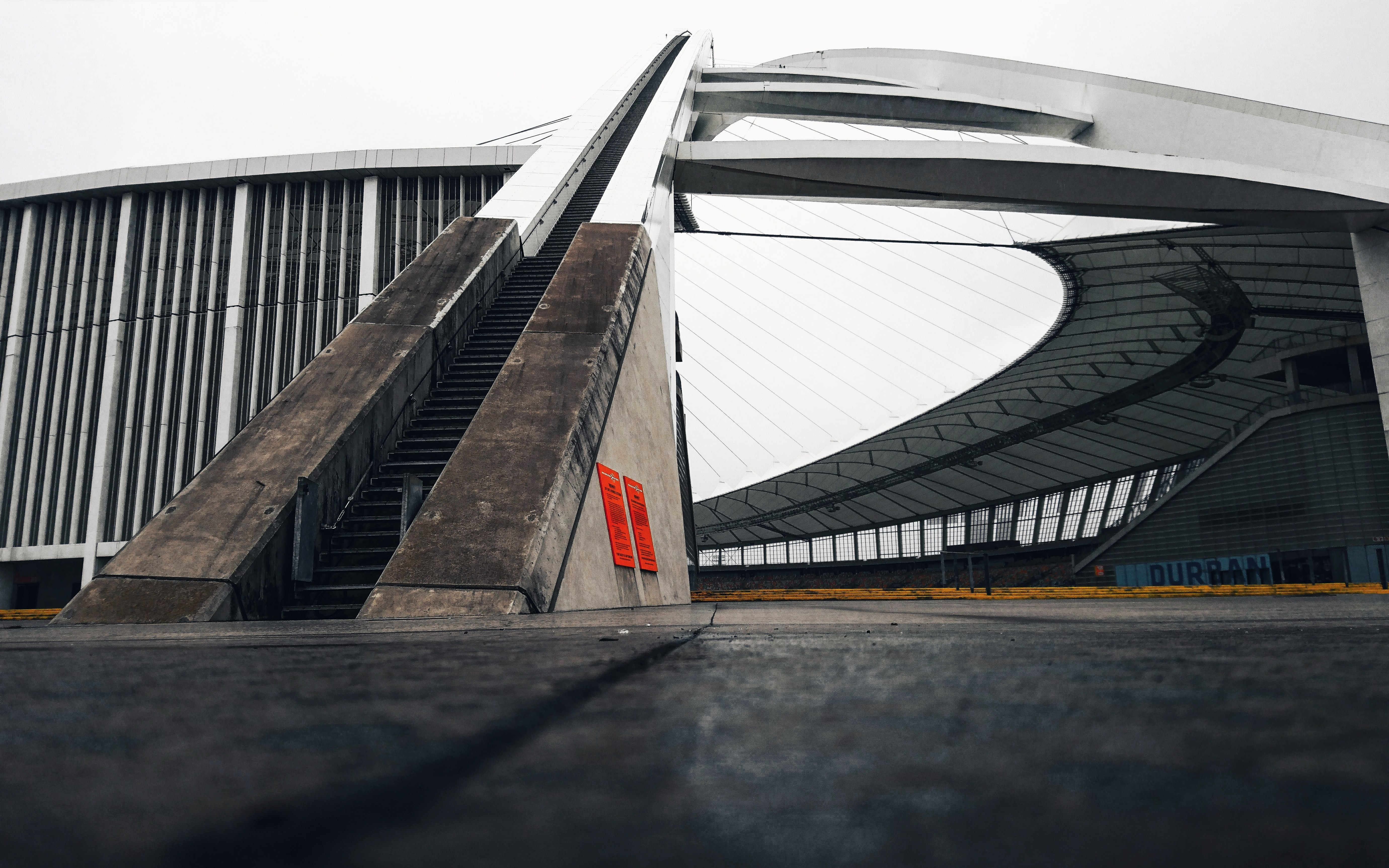 architectural photography of brown and white stairs