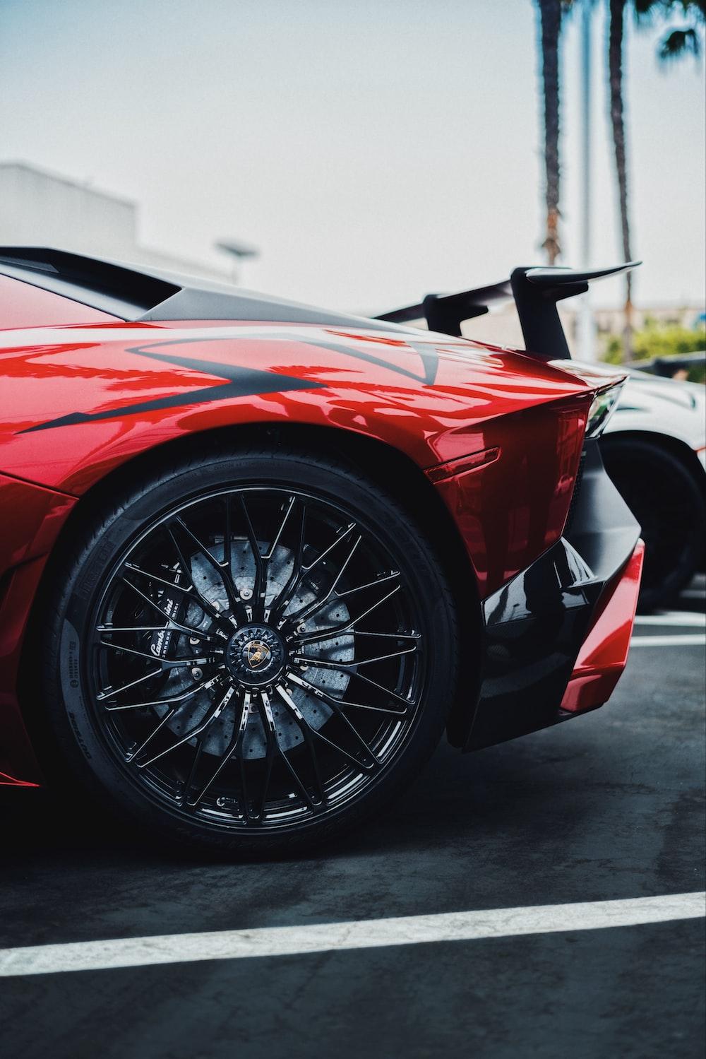 black and red Lamborghini Aventador SV rear left side