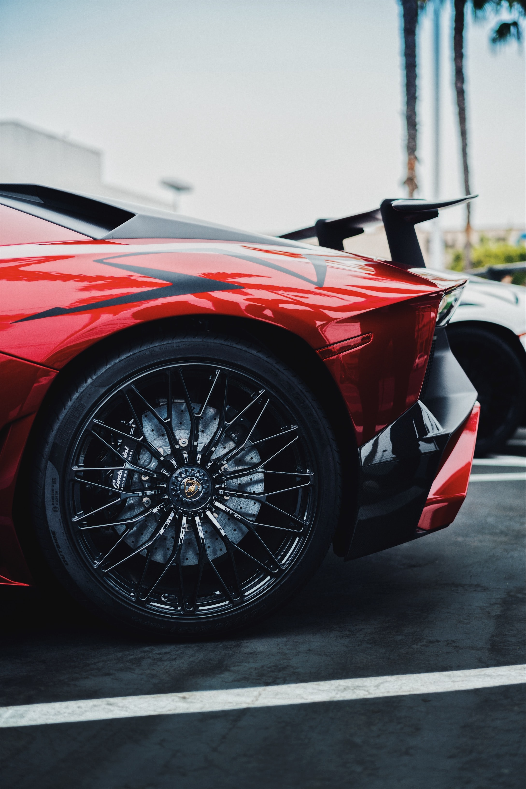 black and red Lamborghini Aventador SV rear left side
