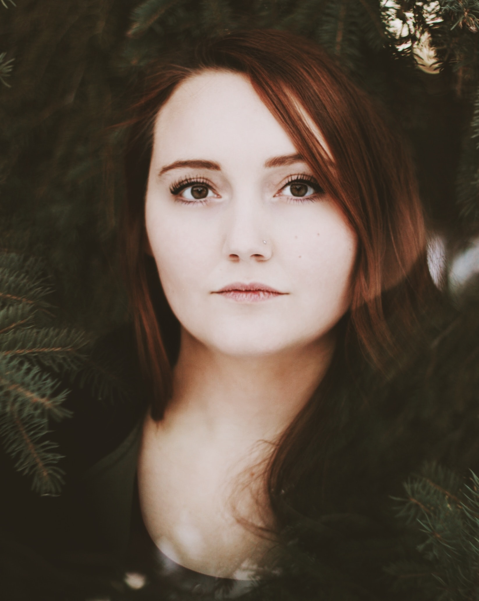 closeup photography of woman near green tree