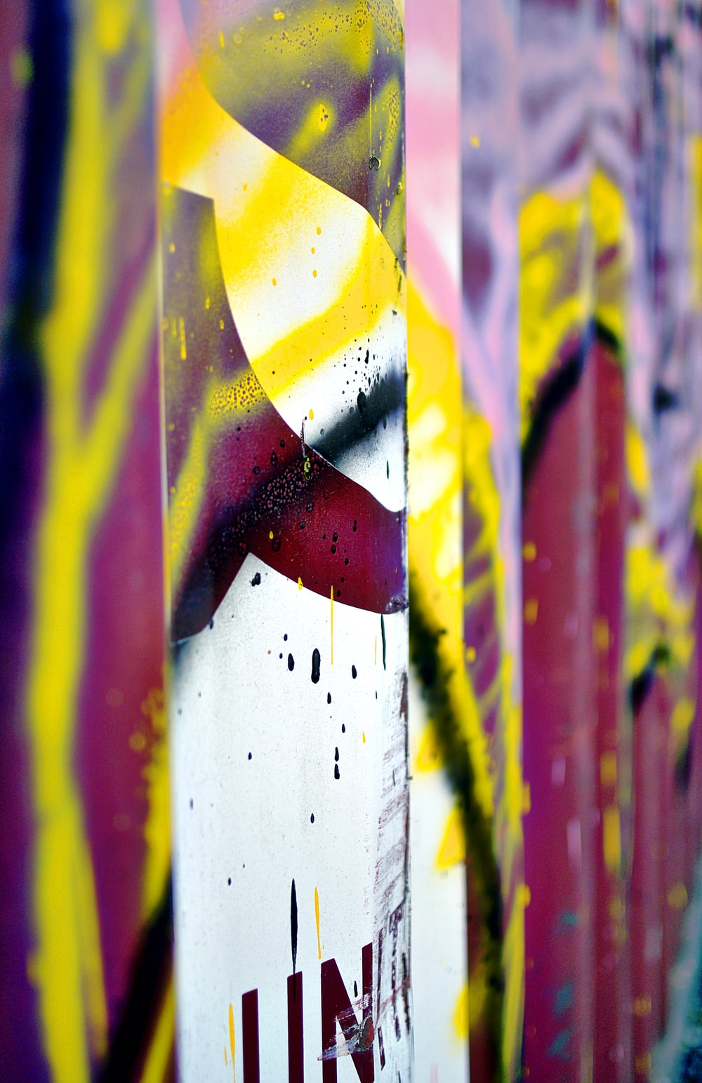 yellow, white, red, and black abstract artwork