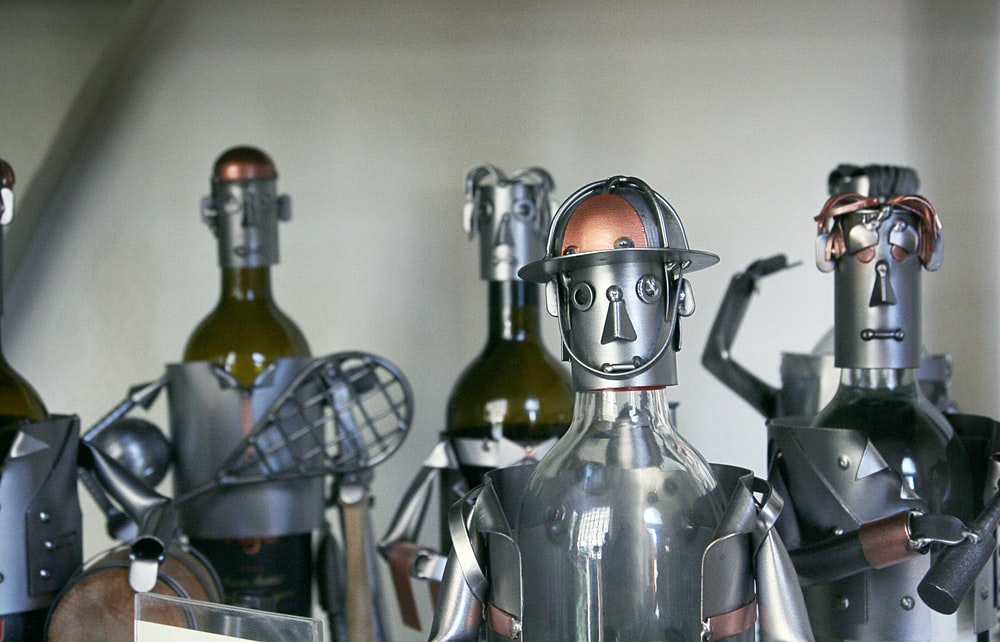 five gray-and-brown metal robots
