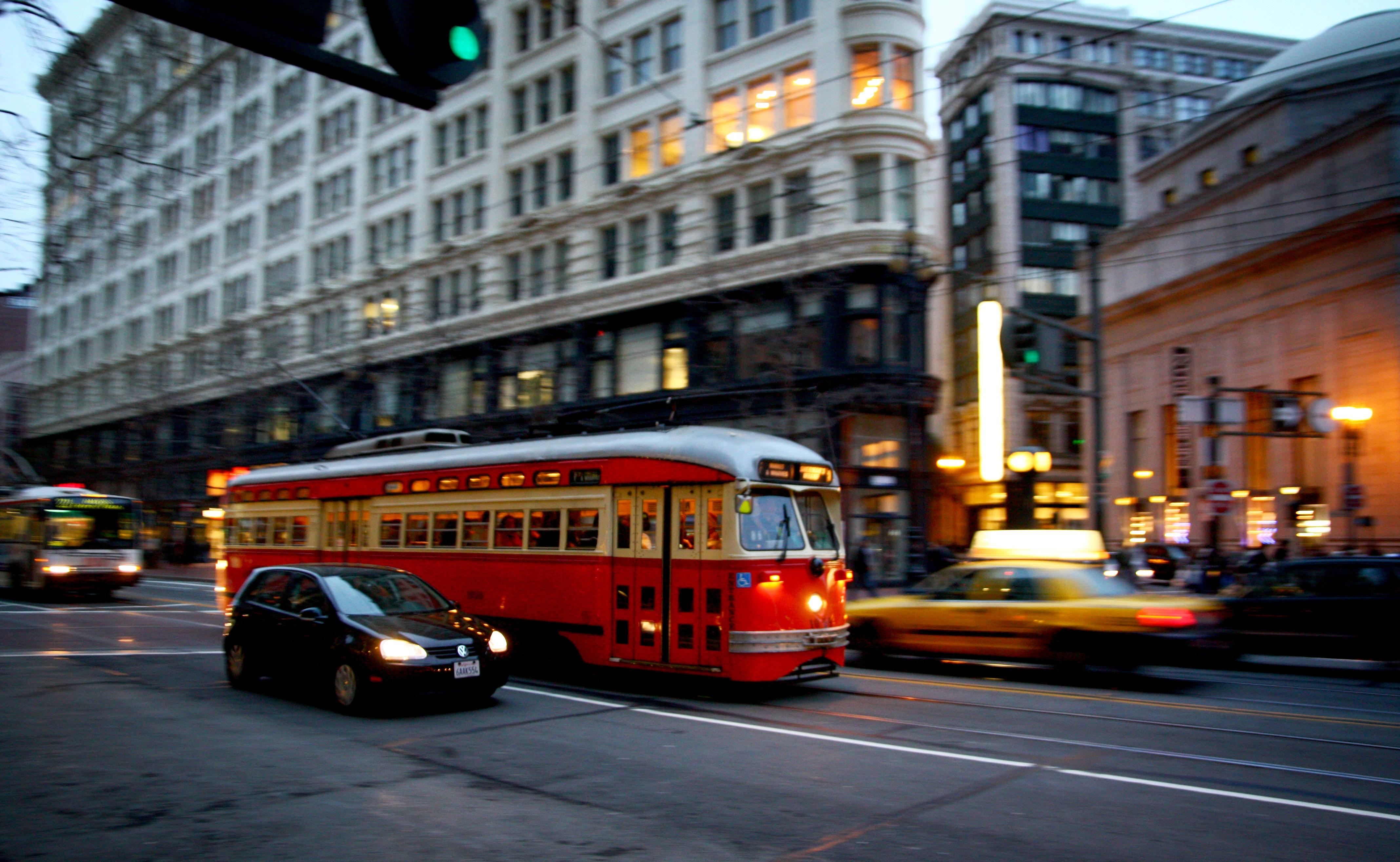 bus near black building