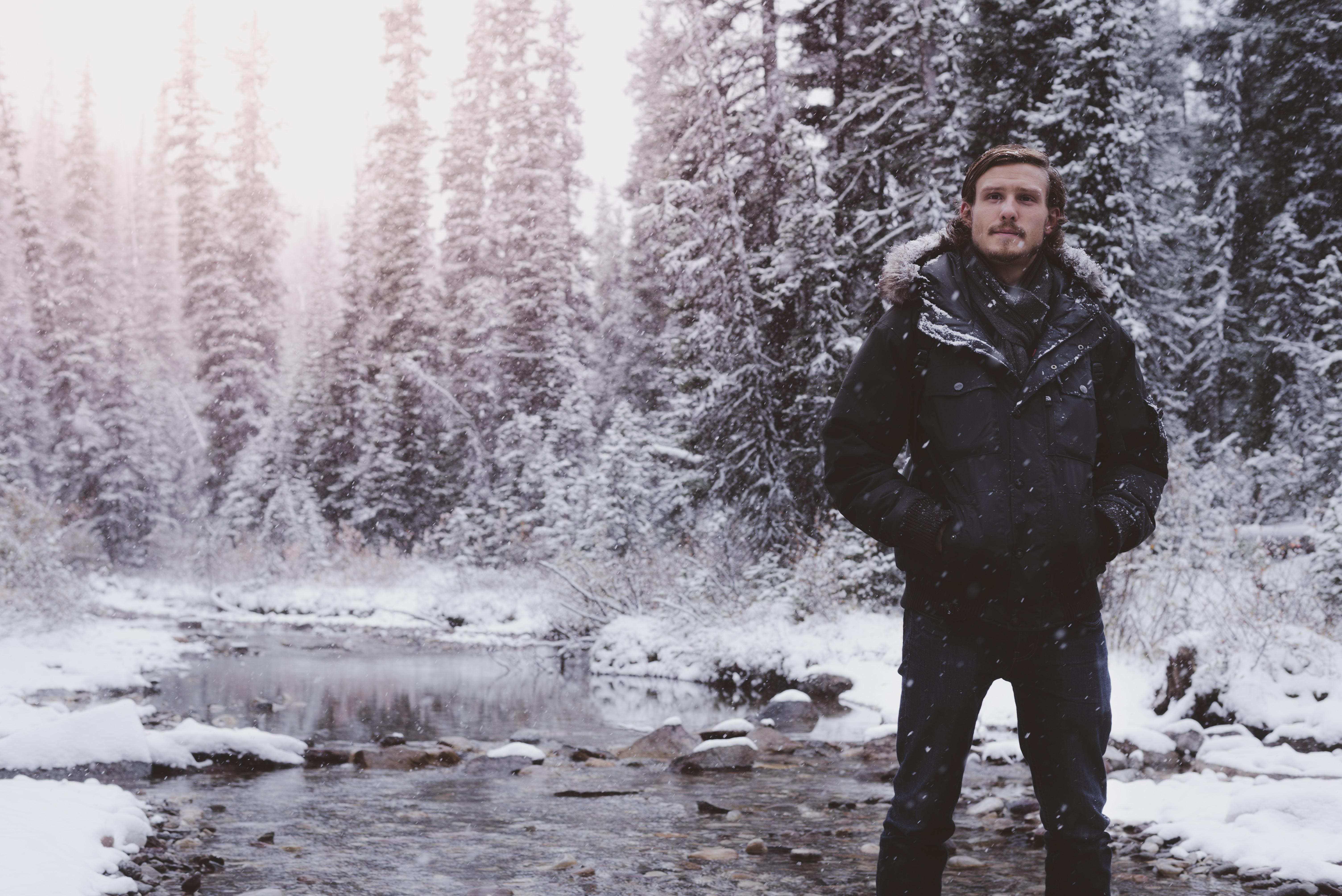 man in black jacket on swamp