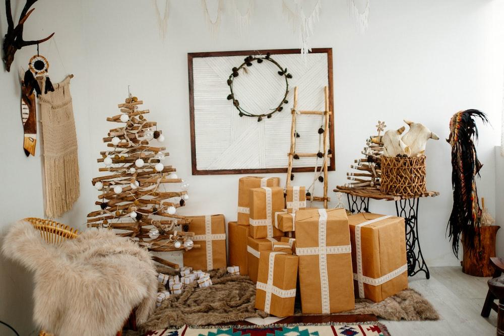 brown cardboard brown beside brown Christmas tree inside room during daytime
